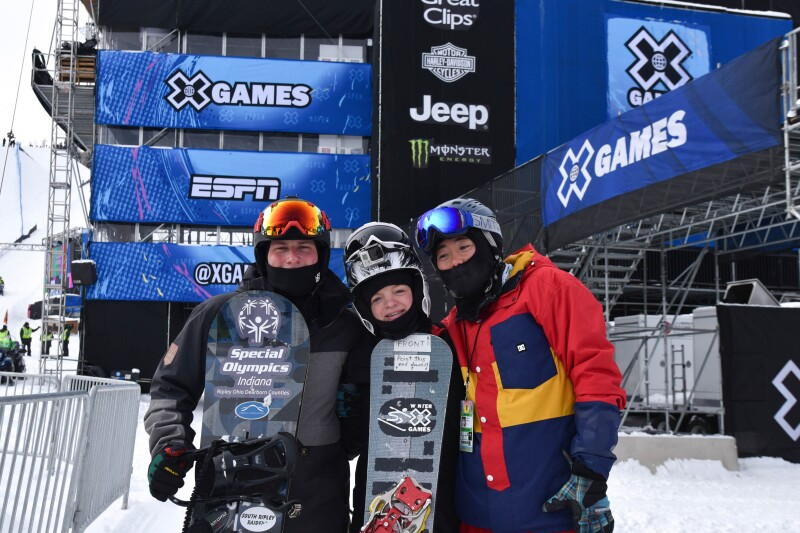 Chris Perdue, Daina Shilts and Henry Meece standing side by side in their winter gear fora  group photo.