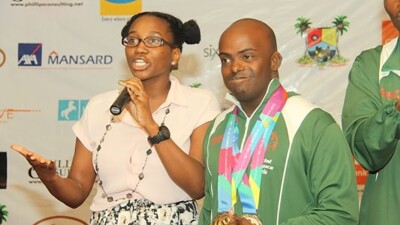 Adedamola and his sister Princess on stage at the Special Olympics World Games Los Angeles 2015 welcome ceremony.