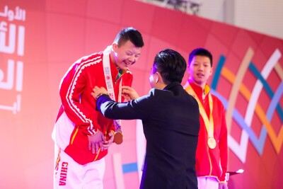 China athlete Li Xiang is awarded a gold medal for gymnastics