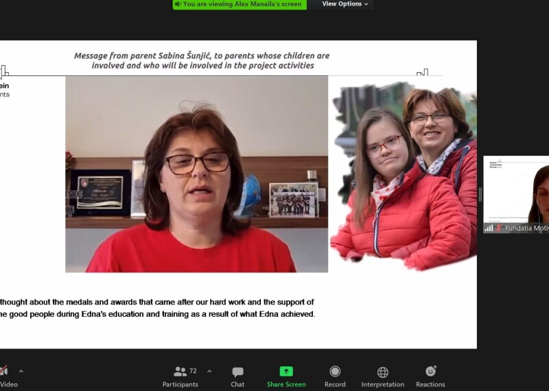 A screenshot of a Zoom meeting featuring a woman in a red t-shirt facing the camera, a photo of the woman with a younger woman.