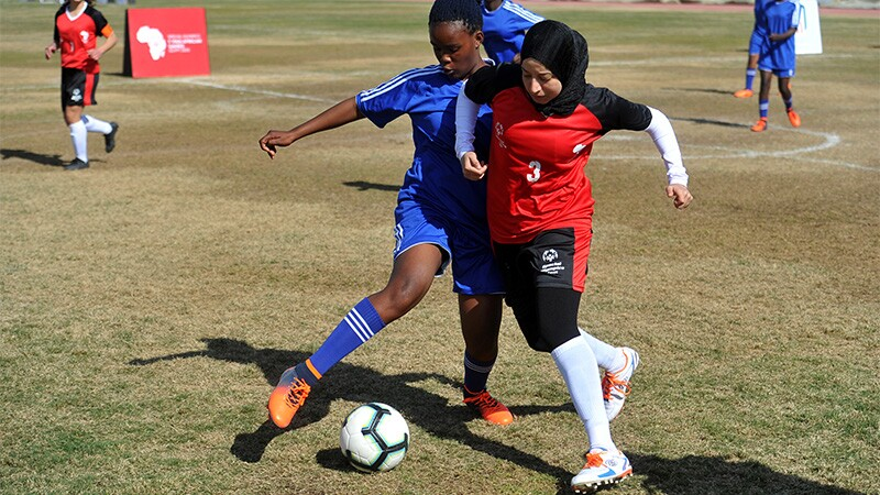 Women playing in football/soccer match
