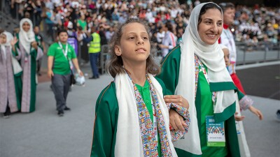 Mother and daughter walking arm in arm at a ceremony durring the 2019 World Games in Abu Dhabi.