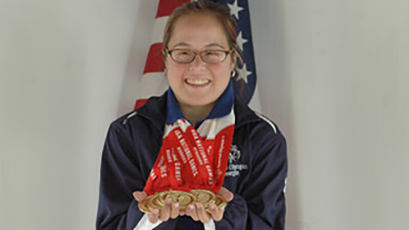 Lani De Mello shows off her medals in gymnastics.