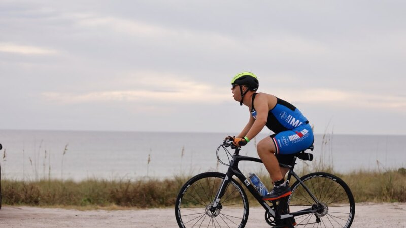 Chris Nikic kept up a steady pace during the 112 mile bike ride despite two falls.