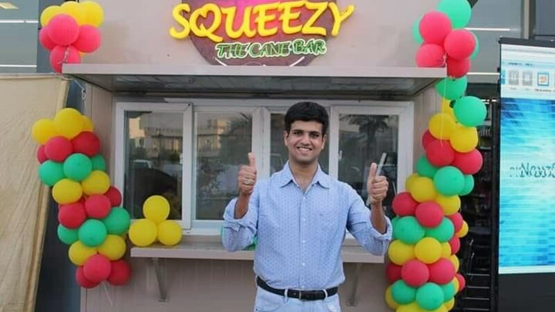 Haseeb in front of his juice bar business, Squeezy the Juice Bar.