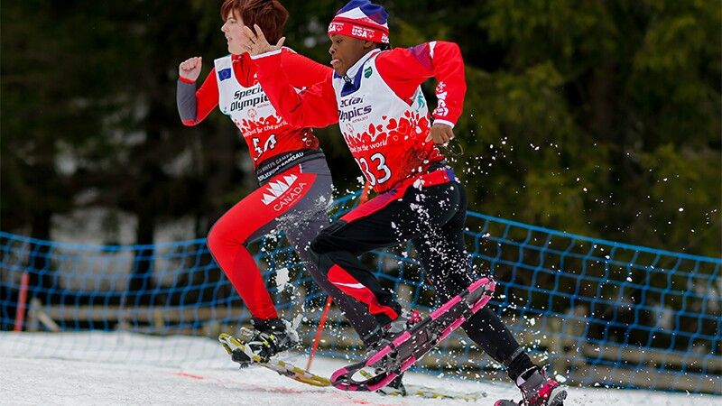 Two snowshoe athletes racing.