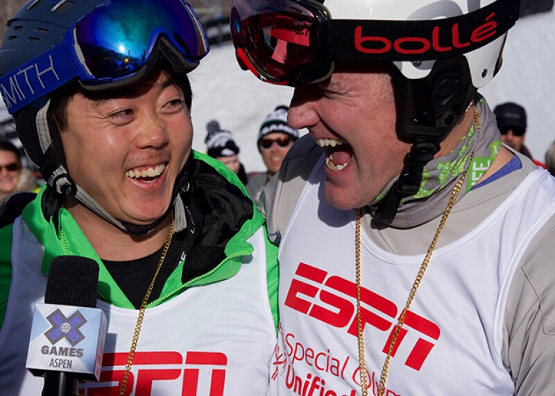 ESPN correspondent interviewing two X-Games snowboarding Unified Athletes.