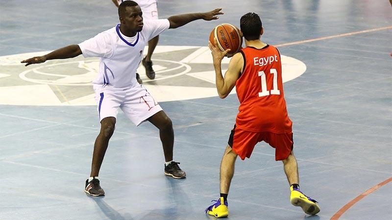 Men playing in basketball match