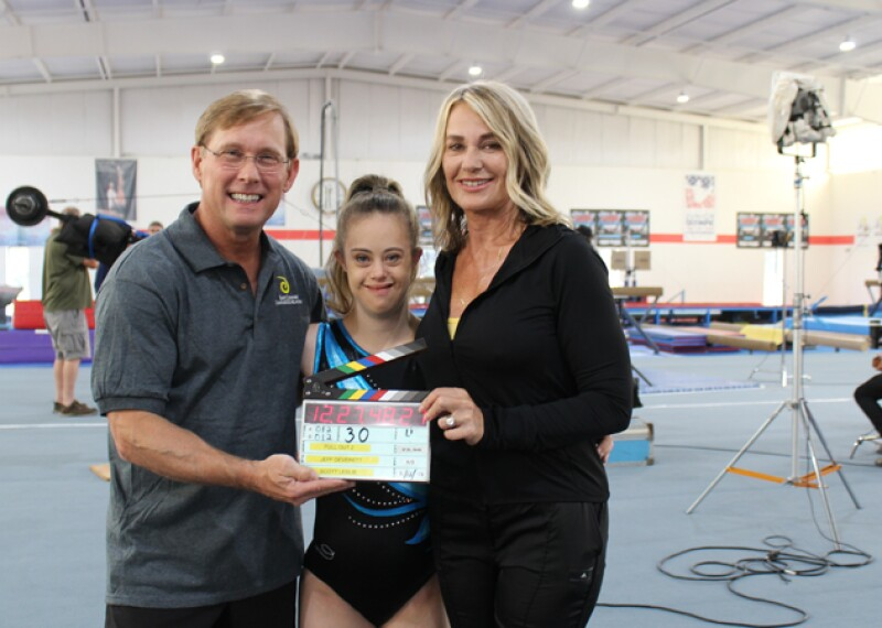 Bart Conner,Chelsea Werner, and Nadia Comaneci on the movie set at the Bart Conner Gymnastics Academy.