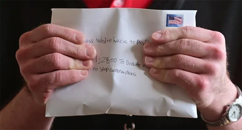 Steven holding an letter he sent to the White House.
