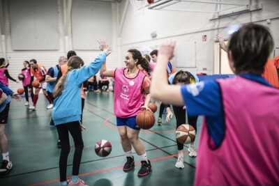 Special Olympics Europe Eurasia Youth Leaders playing in a game of Unified basketball.