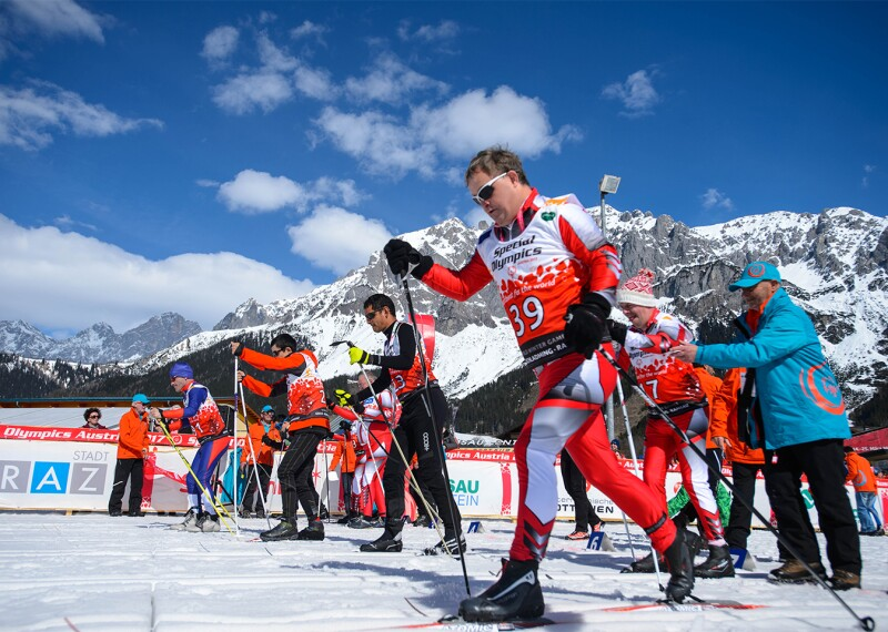 Cross-Country skiers taking off at the start line.