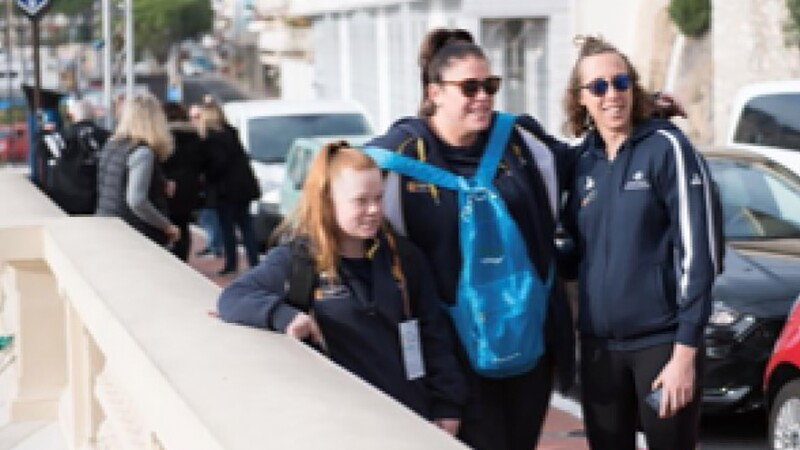 Nicole Harris on the far right standing with two other young teammates.
