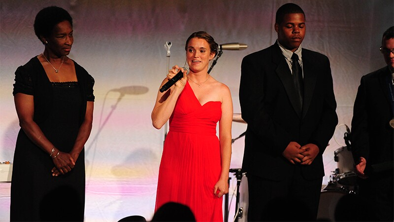 Athlete Loretta Claiborne and Danielle Liebl (speaking) accompanied by Kenny Brown.