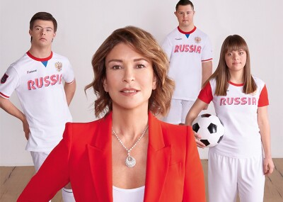 Olga Slutsker and three athletes Masha Budina, Misha Stroyev, and Yan Ovsienko standing together.