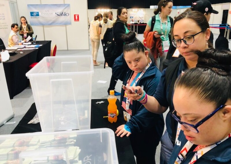 Sayra Paola Barrios, Special Olympics Guatemala Gymnastics athlete, patiently waits to receive her new prescription glasses from the Special Olympics-Lions Club International Opening Eyes Program.