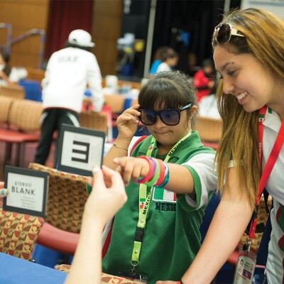 Young athlete receiving an eye exam at a healthy athletes event.