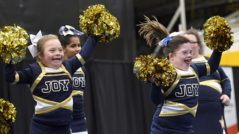 A group of four girls performing a cheer.
