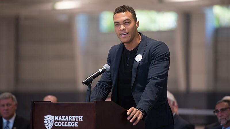 Speaker standing behind podium.