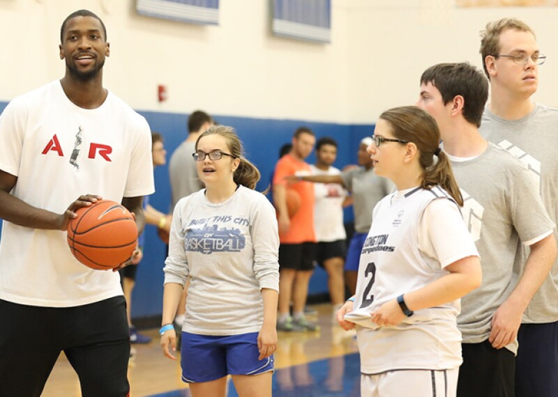 Michael Kidd-Gilchrist on the court with unified athletes giving them a lesson.