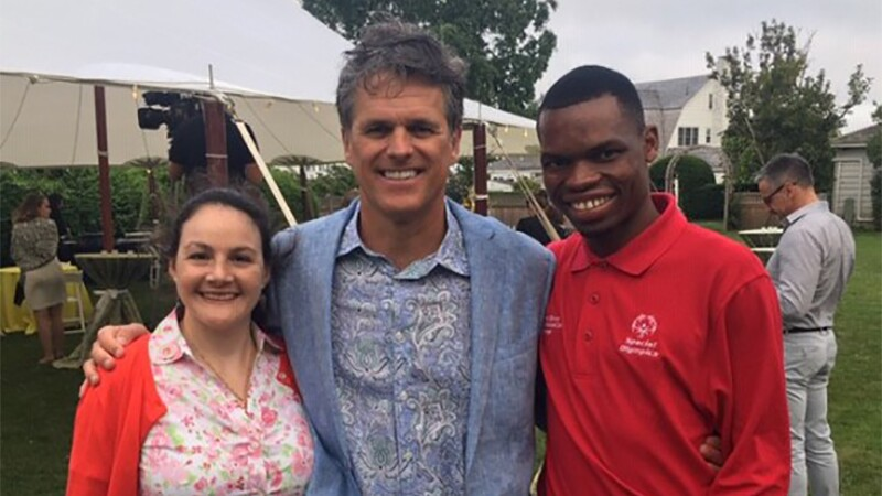 Renee, Tim Shriver and Nyasha Derera pose to commemorate the end of the 50th Year Anniversary Celebration.