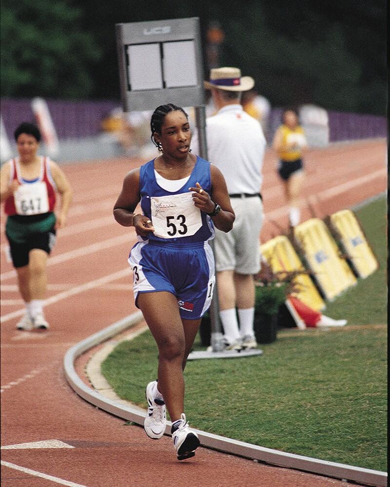 Loretta runs on a track.