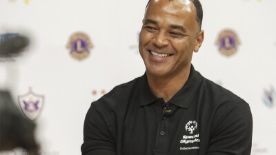 Cafu smiling wearing a black polo that reads, Special Olympics Global Athlete