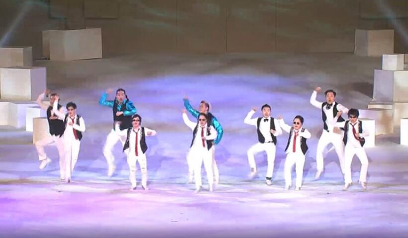 10 dancers performing on stage.