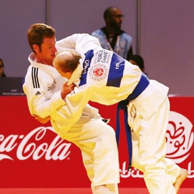 Two athletes competing in judo.