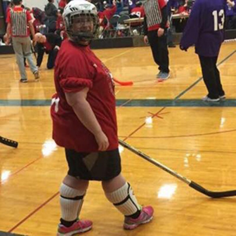 Katye Barton, Special Olympics Minnesota athlete, playing floor hockey.