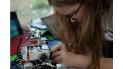 A Unified Robotics competitor puts the finishing touches on her robot.