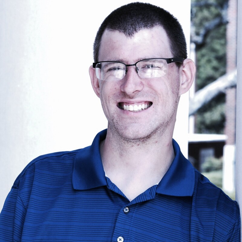 RJ Nealon in a blue polo.