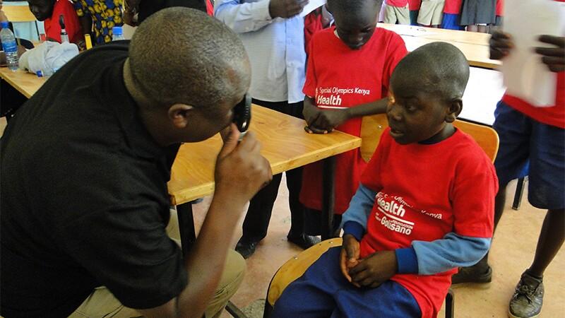 A young boy receiving an eye screening.