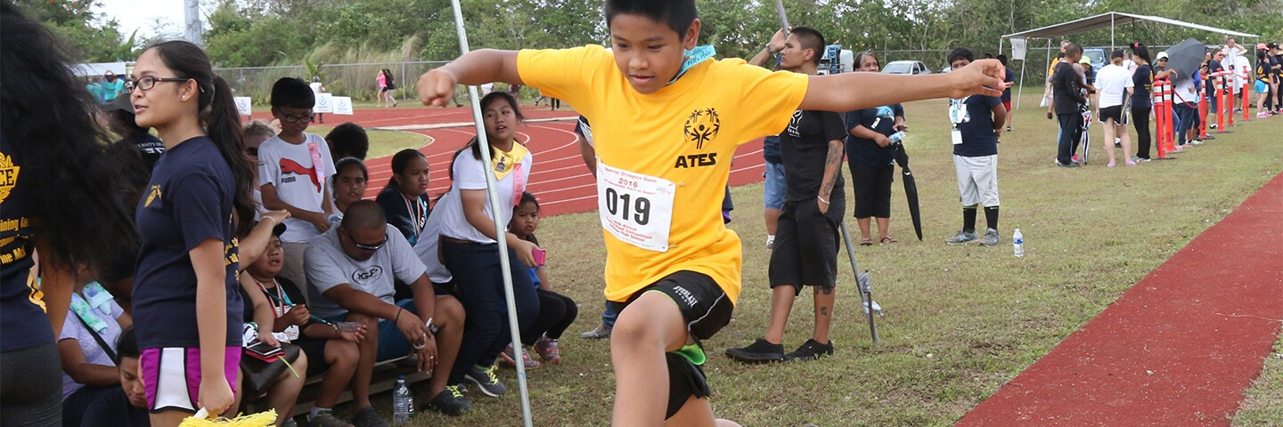 Athlete performing the long jump.