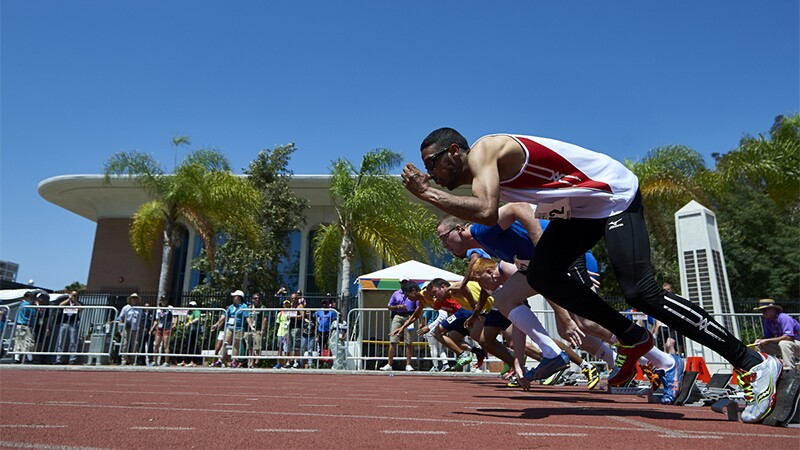 Athletes taking off running at Special Olympics World Summer Games Los Angeles 2015 on the track.