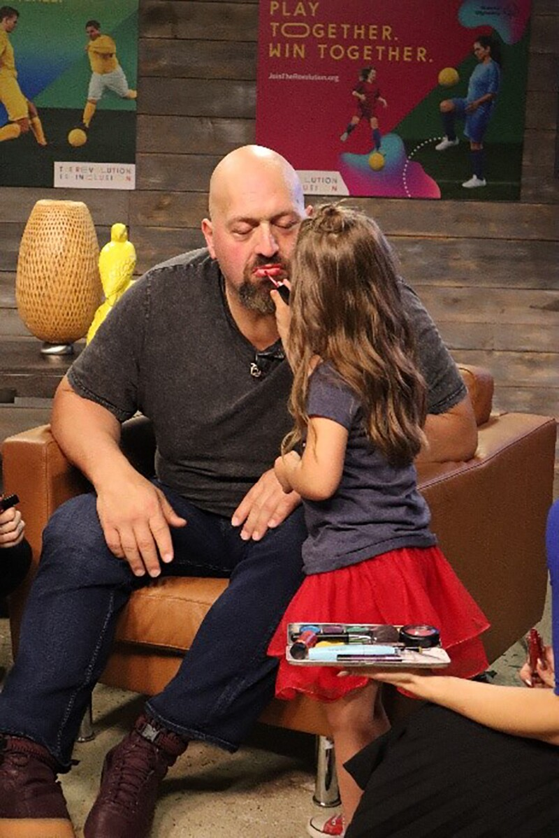 Big Show has make-up applied during a Special Olympics Stream-a-Thon.