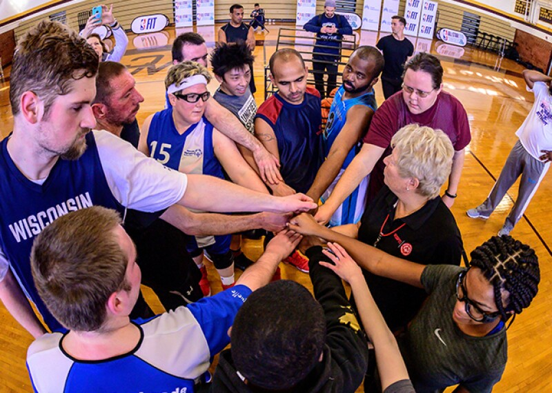 Special Olympics basketball players huddle up during practice the day before the Unified basketball game during NBA All-Star weekend.