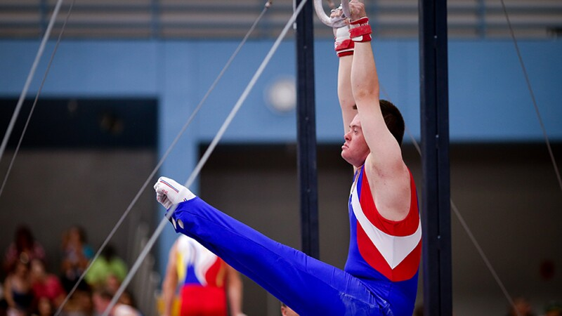 A male gymnast performing on the rings at Special Olympics World Summer Games Los Angeles 2015