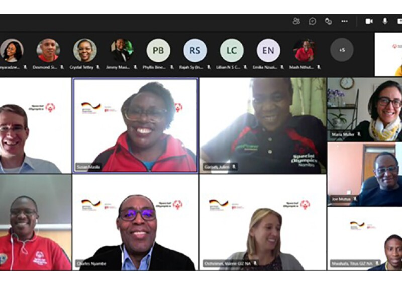 Smiling faces sit on a zoom meeting to discuss new partnership.