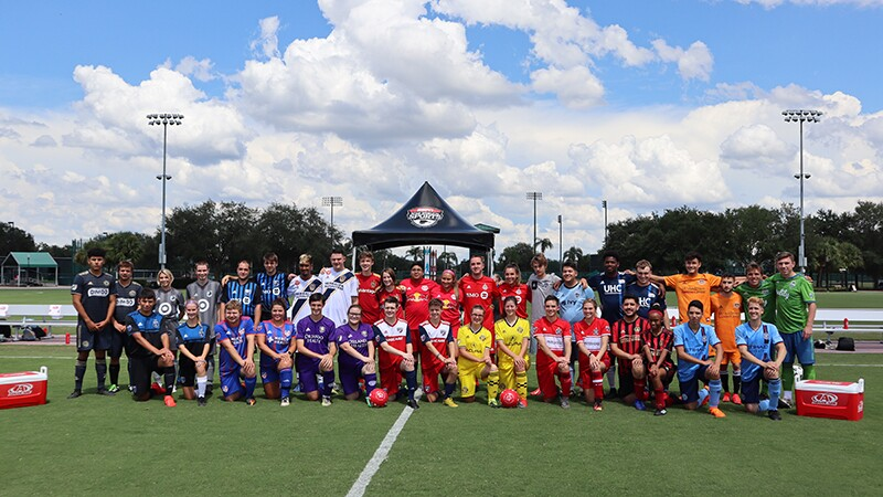 Unified Sport Football (America Soccer) teams on the pitch for a group photo.
