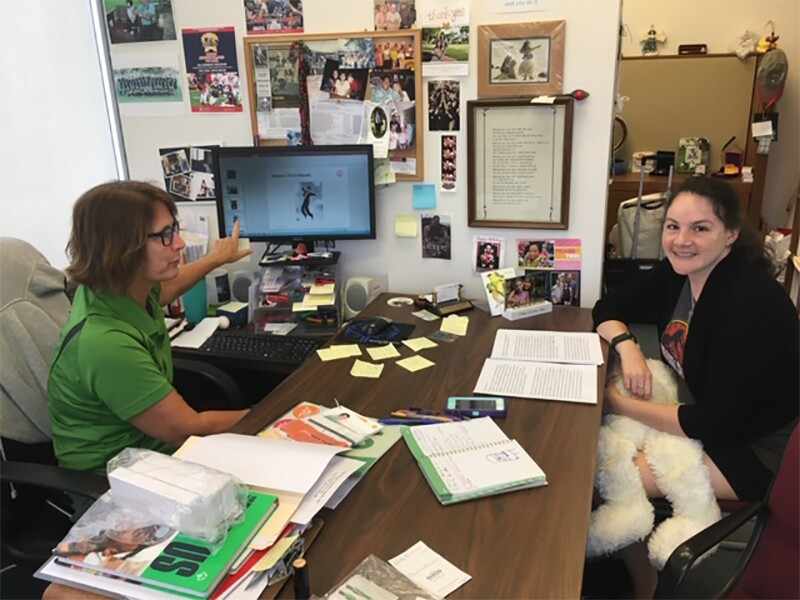 Mentor Nip Ho (left) game-planning with SSIGM and Special Olympics Hawaii athlete Renee Manfredi.