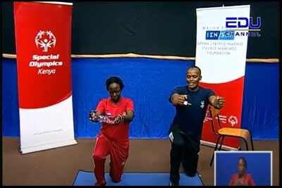 (SO Kenya EDUTV v1 (1).png)- A photo from the EDU-TV broadcast of a Special Olympics coach Vincent Muigai and athlete Shalel Tennah participating in an arm strength exercise.