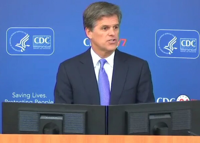 Dr. Timothy Shriver speaking behind a podium at a CDC engagement.