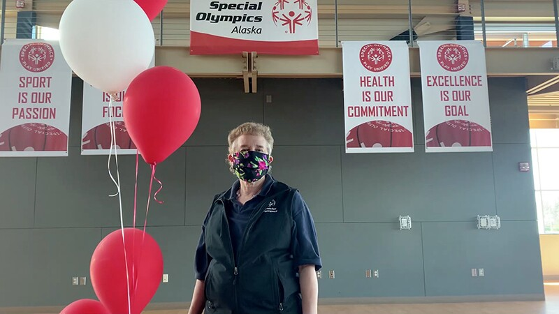 An older woman at the Special Olympics Alaska games wearing a face mask.