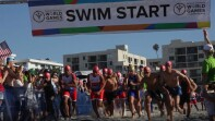 Athletes starting a race on the beach.