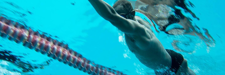Athlete swimming under water.