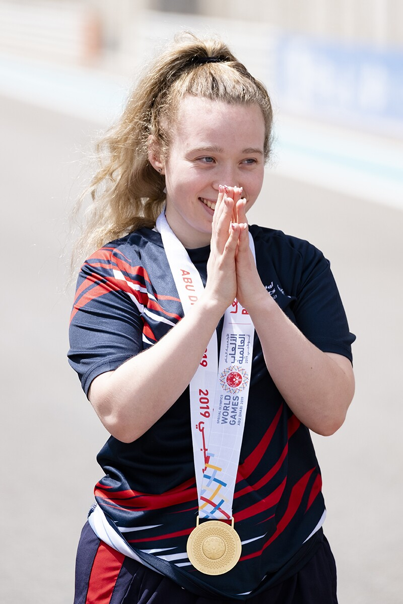 Kiera Byland standing with a gold medal around her neck.