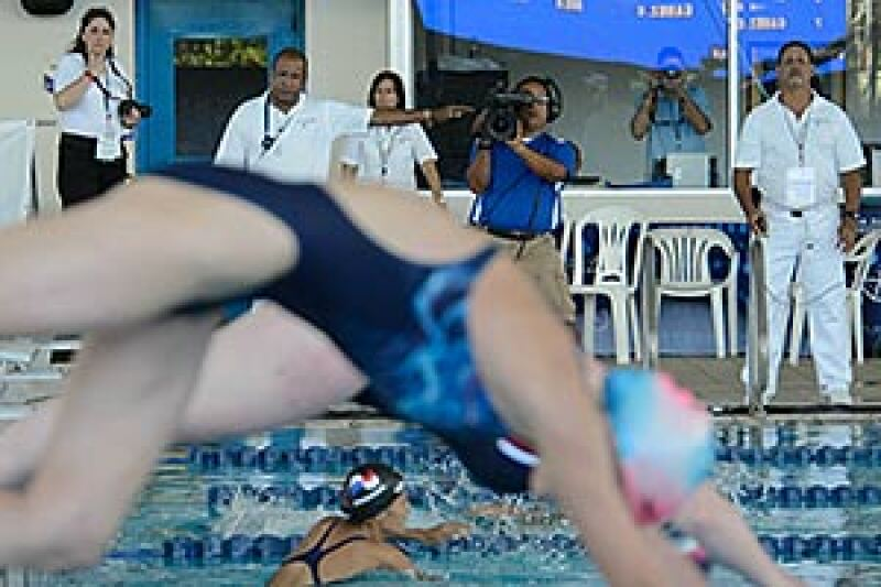 Officials in white shirts observe the start of a race at the Special Olympics World Aquatics Invitational in Puerto Rico in 2012.