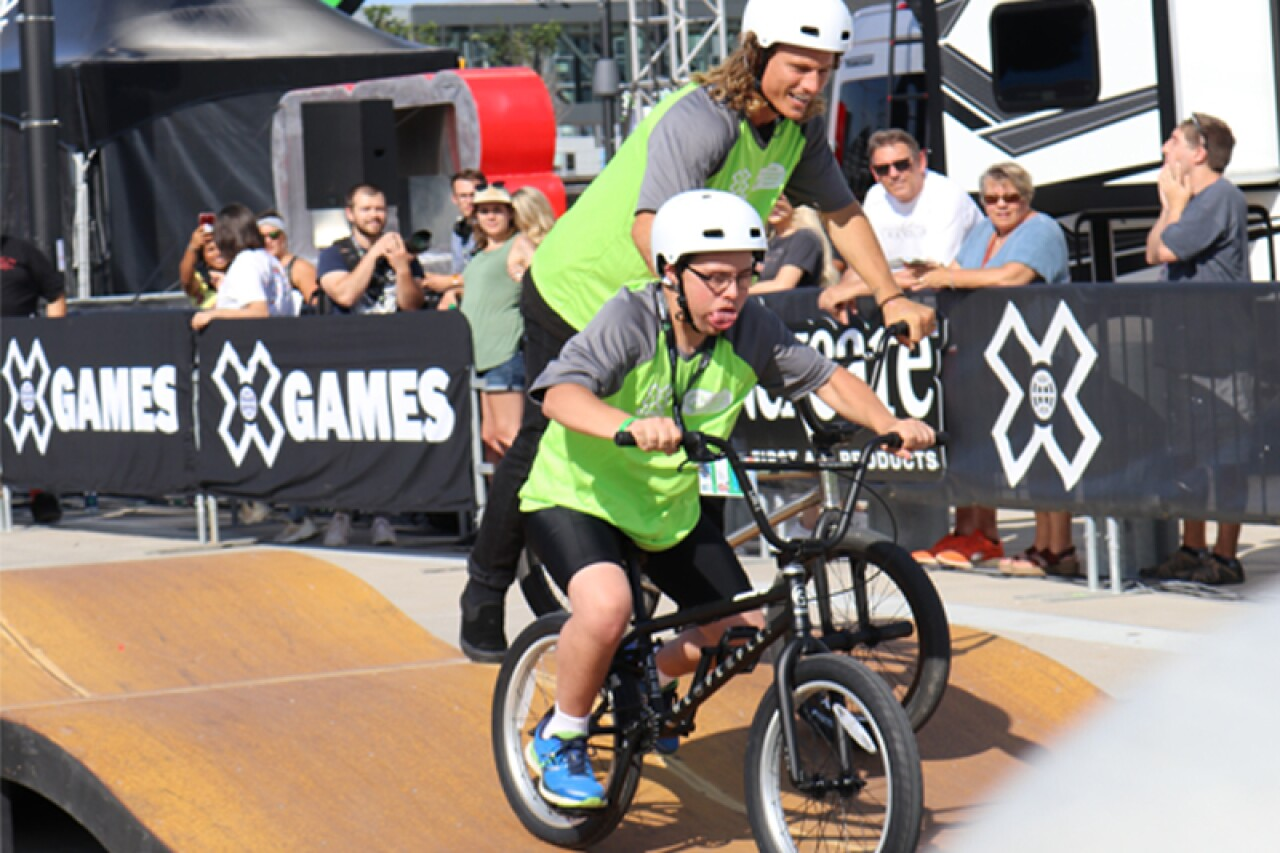 Teammates Camilo Mejia (SO Minnesota) and Dennis Enarson (10-time X Games medalist) demonstrate the power of inclusion during competition.