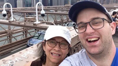 Daniel captures the scenery of New York while on the Brooklyn Bridge with his mother.